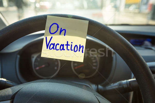 Vacation Concept On Steering Wheel Stock photo © AndreyPopov