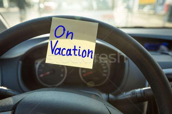 Vacaciones volante primer plano escrito coche papel Foto stock © AndreyPopov
