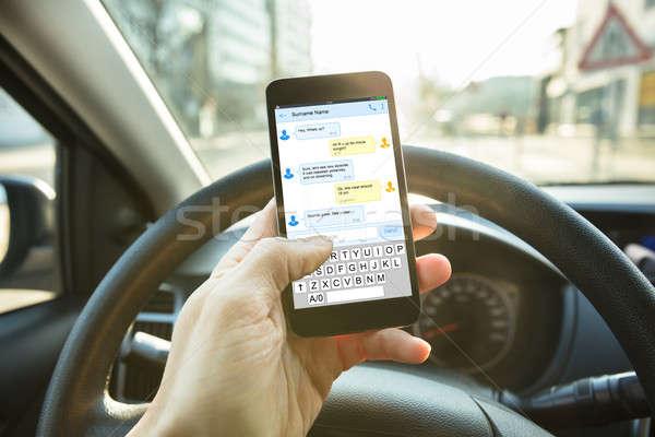 Személy küldés üzenet mobiltelefon közelkép szöveges üzenet Stock fotó © AndreyPopov