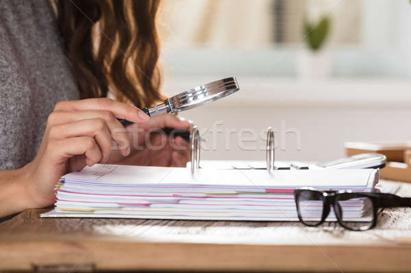 Auditor Looking Invoice Through Magnifying Glass Stock photo © AndreyPopov