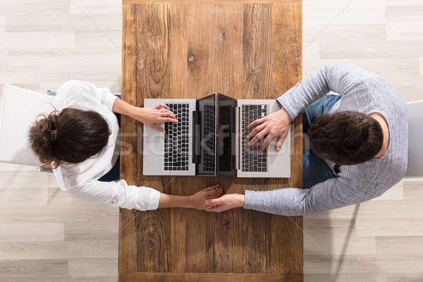 Overhead View Of Couple Using Laptop Stock photo © AndreyPopov