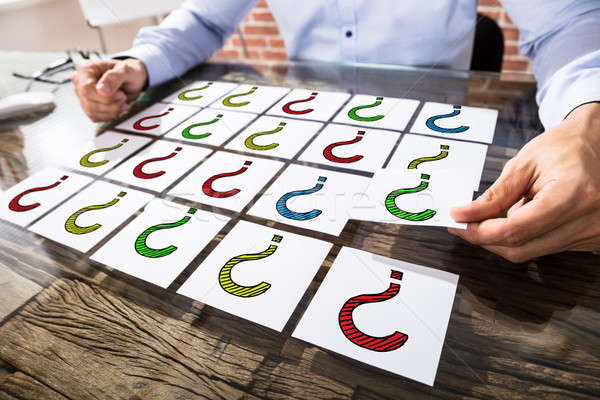 üzletember tart kérdőjel tapadó jegyzetek színes Stock fotó © AndreyPopov