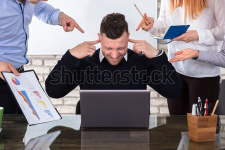 Angry Business People Pointing At Colleague Stock photo © AndreyPopov