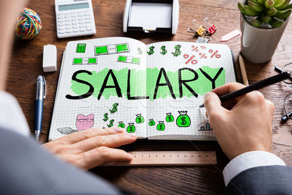 Man Drawing Salary Word Stock photo © AndreyPopov