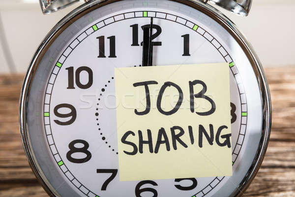 Job Sharing Adhesive Note Stuck On Alarm Clock Stock photo © AndreyPopov