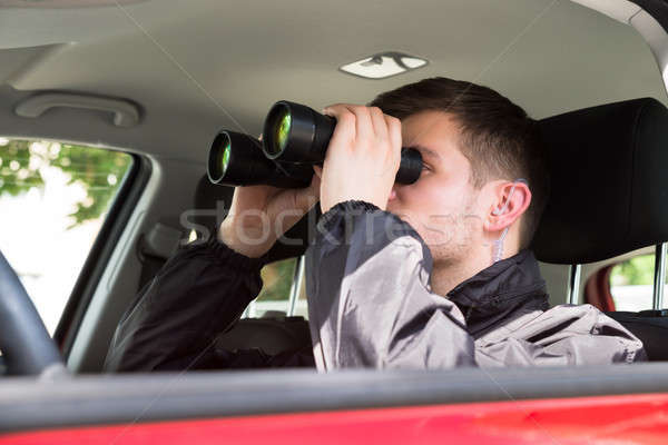 Close-up Of A Man Looking Through Binocular Stock photo © AndreyPopov