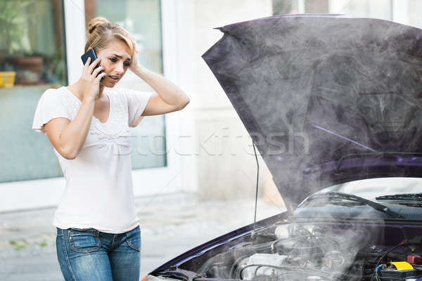 Woman Talking On Mobile Phone In Front Of Car Stock photo © AndreyPopov