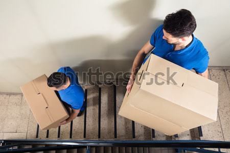 Two Movers Carrying Cardboard Boxes On Staircase Stock photo © AndreyPopov