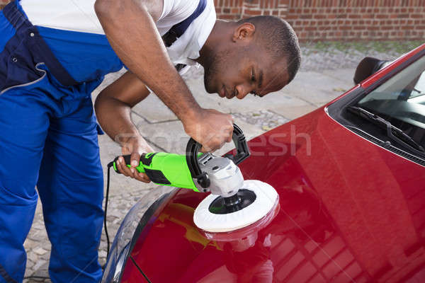 Hands Polishing Car With Orbital Polisher Stock photo © AndreyPopov