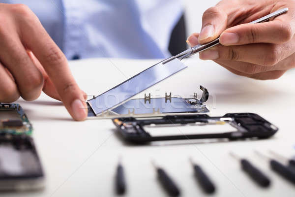 Technician Fixing Damaged Screen On Mobile Phone Stock photo © AndreyPopov