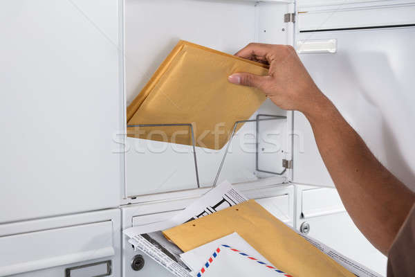 Postman Taking Letters From Mailbox Stock photo © AndreyPopov