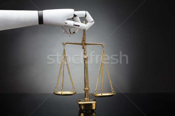 Robot's Hand Holding Justice Scale Stock photo © AndreyPopov