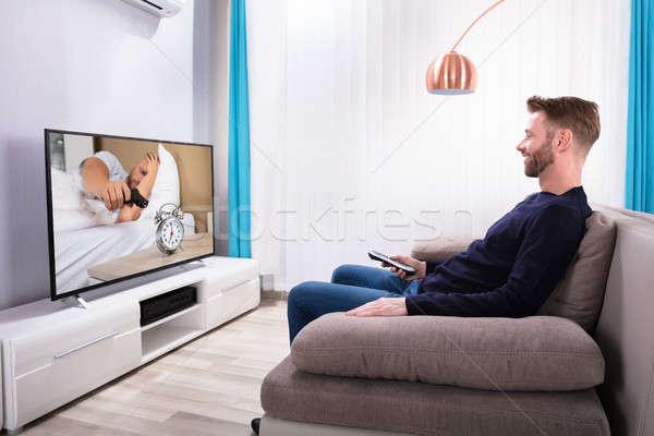 Man Sitting On Sofa Watching Television Stock photo © AndreyPopov