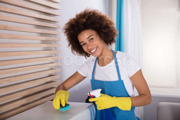 Janitor Cleaning White Cabinet With Sponge Stock photo © AndreyPopov