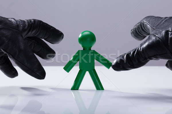 Thief Stealing Green Human Figure Stock photo © AndreyPopov