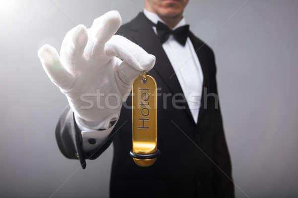 Receptionist Holding Hotel Door Key Stock photo © AndreyPopov