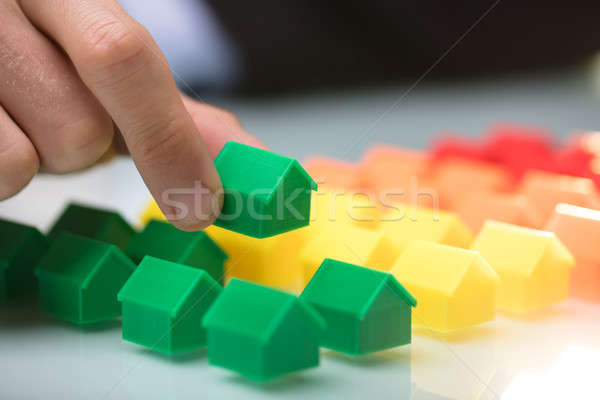 Person Arranging Green House Model Stock photo © AndreyPopov