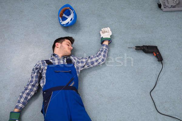 Inconsciente handyman piso ver capacete três de um tipo Foto stock © AndreyPopov