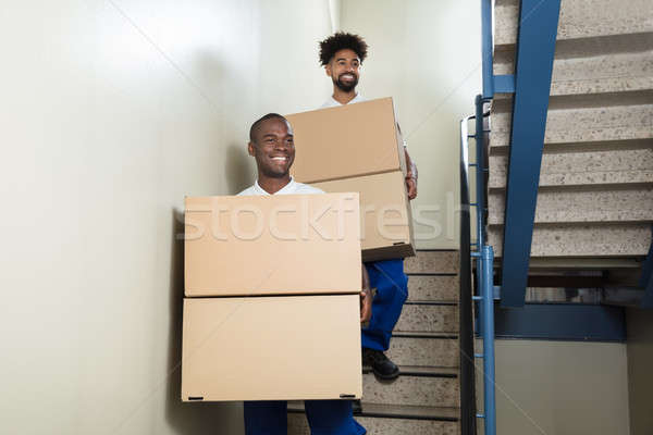 Portrait Of Two Movers Holding Cardboard Boxes Stock photo © AndreyPopov