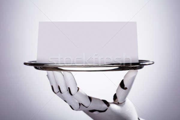 Robot tart üres kártya tányér robotikus kéz Stock fotó © AndreyPopov