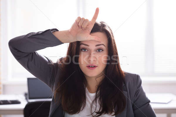 Businesswoman Showing Loser Sign Stock photo © AndreyPopov