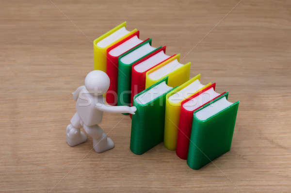 Human Figure Selecting Green Book Stock photo © AndreyPopov