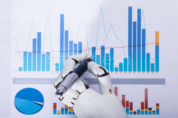 Robot Using Pen While Working On Graph Stock photo © AndreyPopov