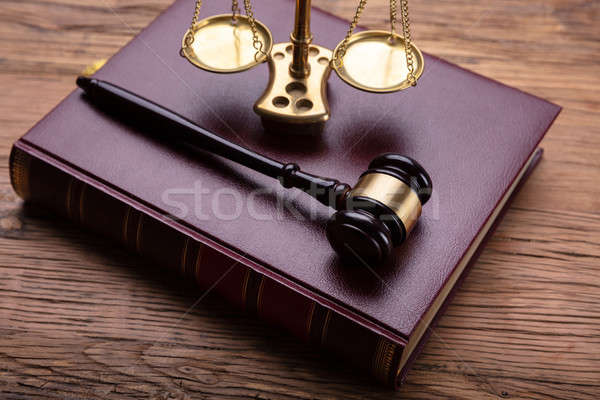 Elevated View Of Mallet And Justice Scale Over Law Book Stock photo © AndreyPopov