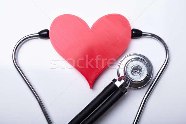 Megvizsgál piros szív sztetoszkóp fehér háttér Stock fotó © AndreyPopov