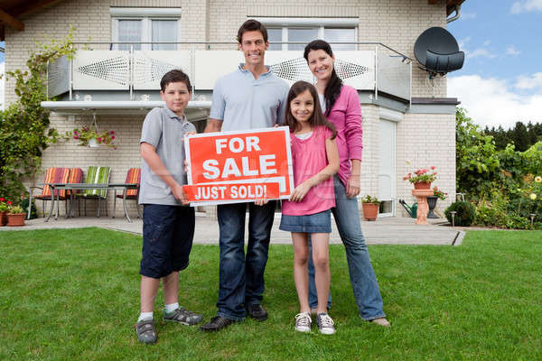 Happy family buying new house Stock photo © AndreyPopov