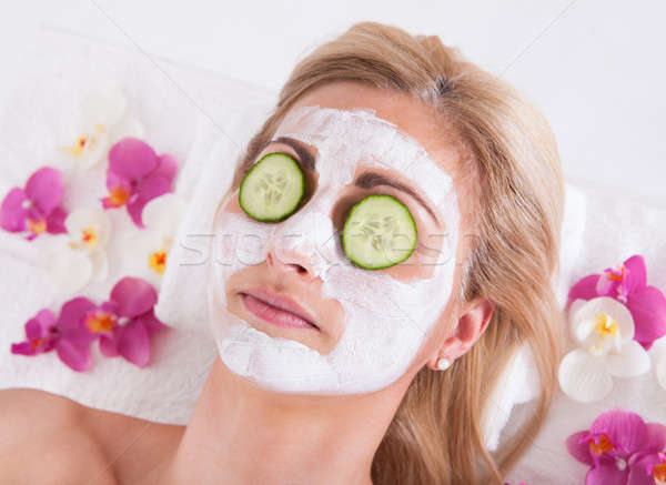 Cosmetician Applying Facial Mask On Face Of Woman Stock photo © AndreyPopov