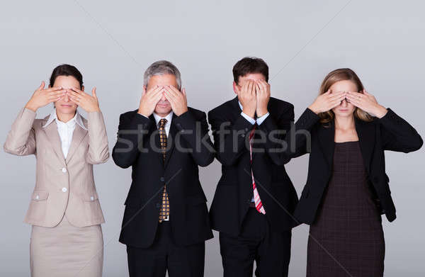 Four businesspeople holding their eyes shut Stock photo © AndreyPopov