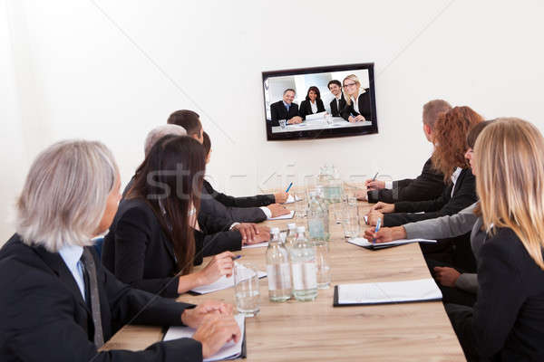 Businesspeople Sitting At Conference Table Stock photo © AndreyPopov