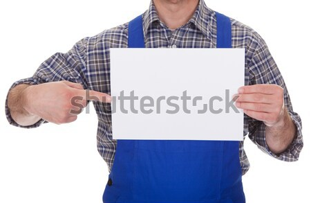 Mature Male Technician Holding Visiting Card Stock photo © AndreyPopov