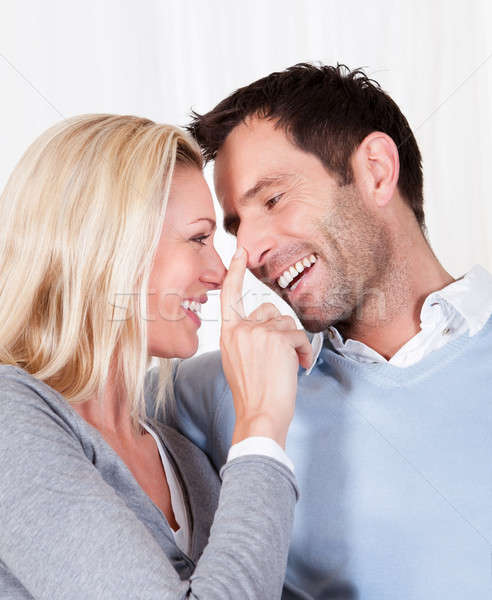 Woman touching her husband on the nose Stock photo © AndreyPopov