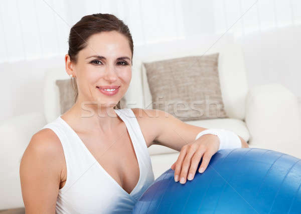 Happy woman with a pilates ball Stock photo © AndreyPopov
