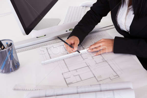 Close-up Of Female Architect Drawing Blueprint Stock photo © AndreyPopov