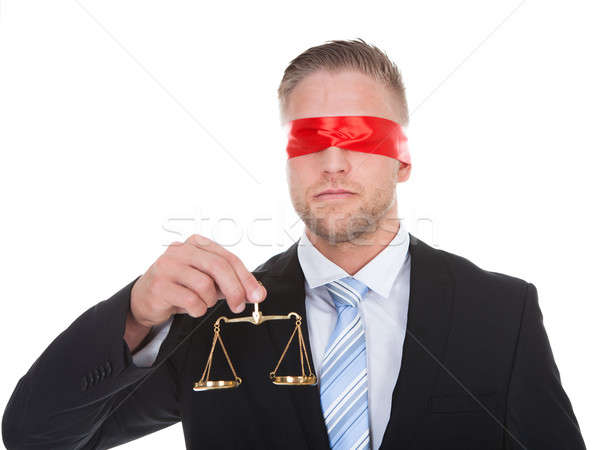 Lawyer with scales of justice wearing a blindfold Stock photo © AndreyPopov