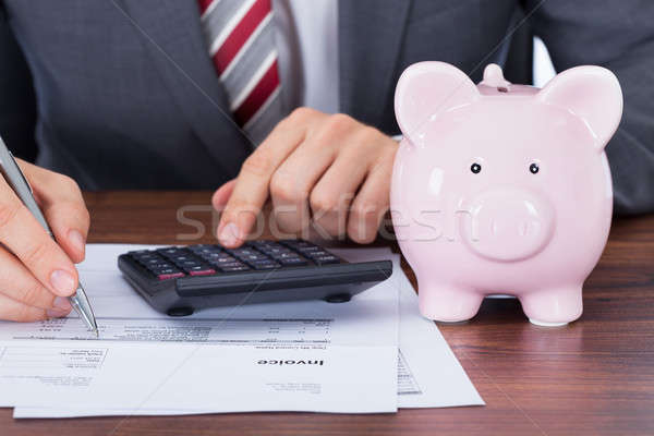 Empresário secretária moedas dinheiro Foto stock © AndreyPopov