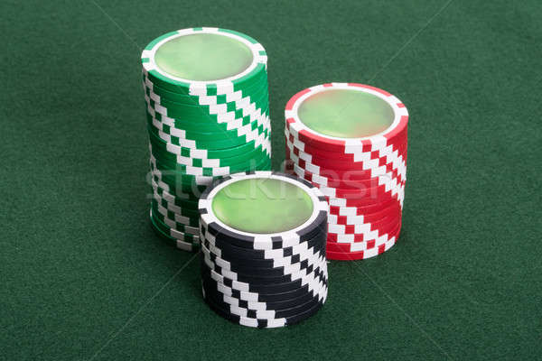 Casino chips on poker table Stock photo © AndreyPopov