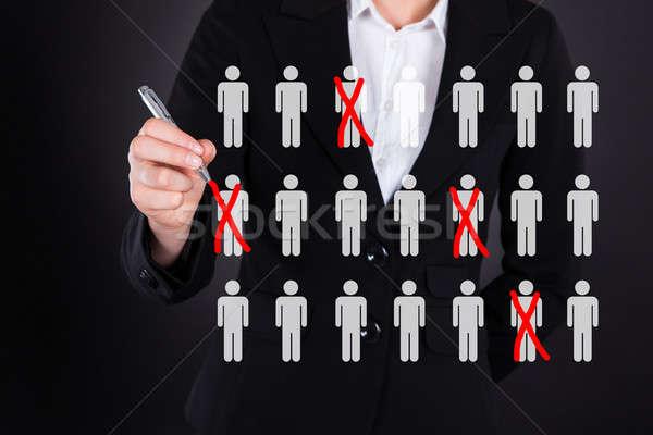 Businesswoman Striking Out Employees Stock photo © AndreyPopov