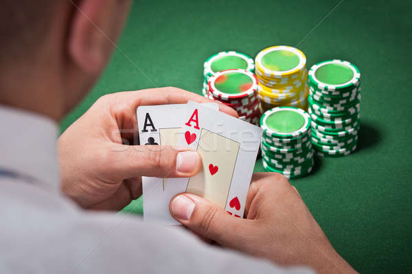 Stock photo: Man With Ace Cards Playing Poker