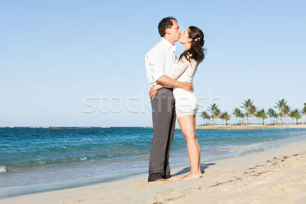 Affectionate Couple Kissing At Beach Stock photo © AndreyPopov