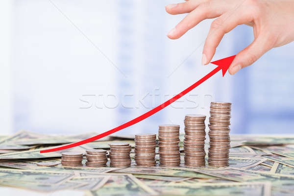 Hand Holding Arrow Sign Above Progressive Bargraph Stock photo © AndreyPopov