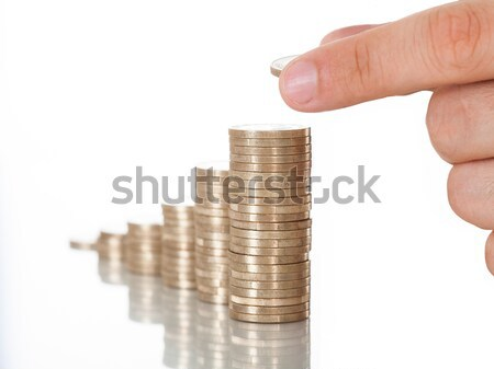 Man Stacking Coins At Desk Stock photo © AndreyPopov