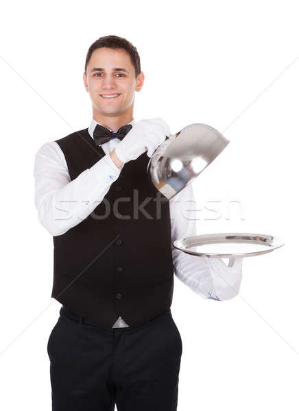 Waiter Holding Lid Cover Over Empty Tray Stock photo © AndreyPopov