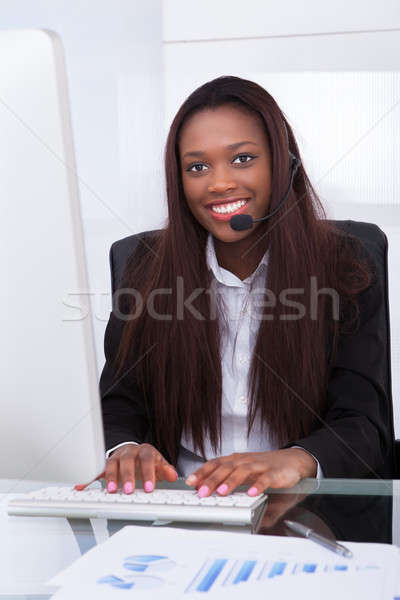Customer service representative working at desk in office Stock photo © AndreyPopov