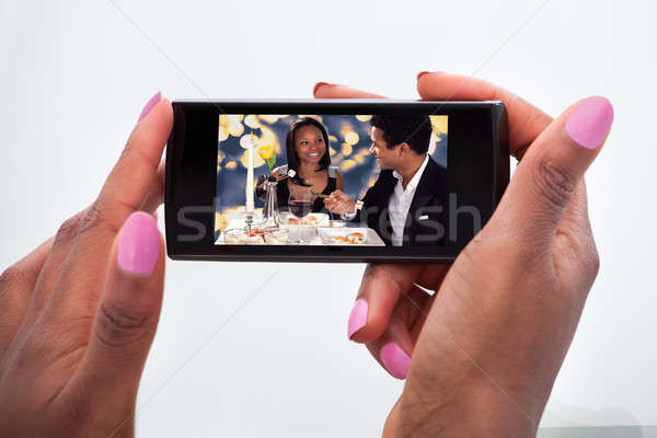 Woman Watching Video On Mobile Phone At Home Stock photo © AndreyPopov
