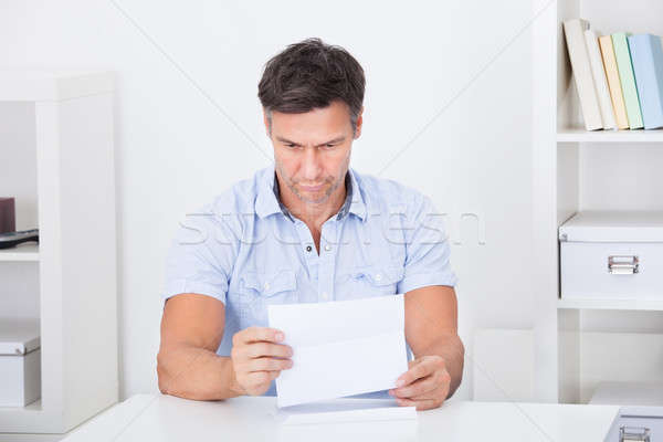 Depressed Man Reading Paper Stock photo © AndreyPopov