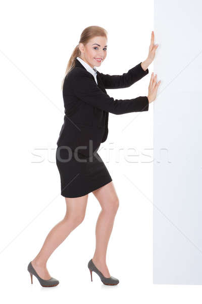 Young Businesswoman Pushing Placard Stock photo © AndreyPopov